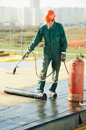 Picture of man working on commercial roof