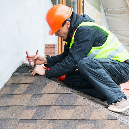 A Roofer Works on a Roof Repair.