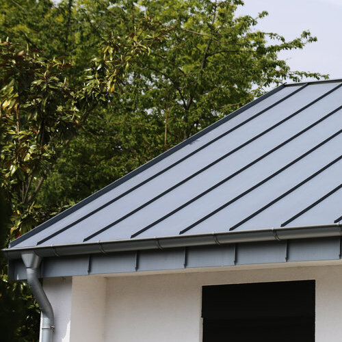 Building with standing seam metal roof.