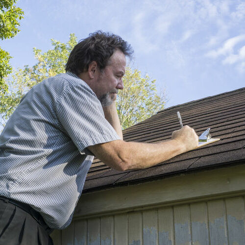 inspecting roof for hail damage repair needs